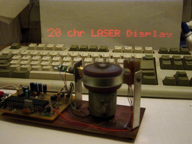 Mechanically scanned laser display