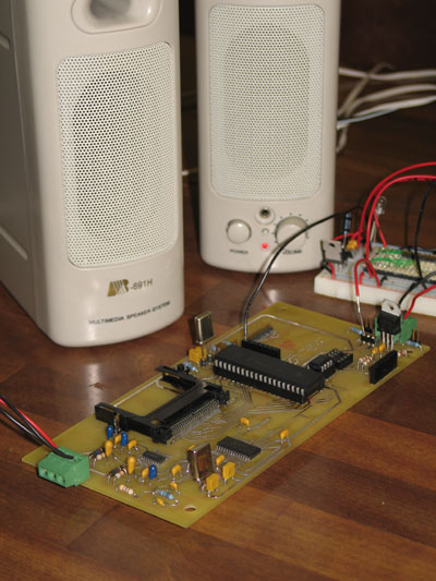 Wireless Interactive Media Player (WIMP) and two speakers